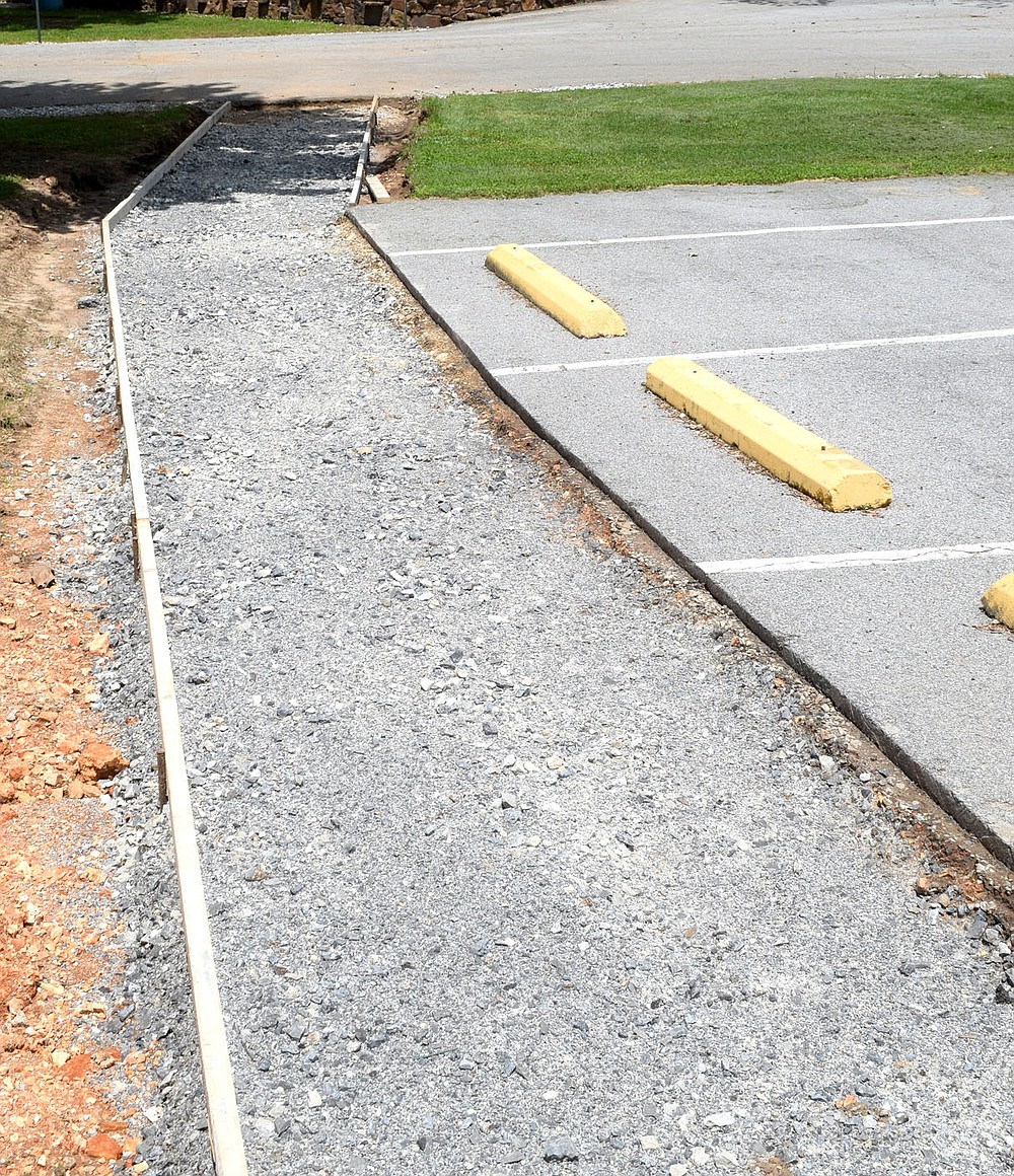 Westside Eagle Observer/MIKE ECKELS A new sidewalk leading from the Bunker to Pat Streets awaits concrete fill at Veteran Park in Decatur Thursday afternoon. Once this walkway is complete it will provide better handicap accessibility to the Bunker during events such as the Decatur Barbecue.
