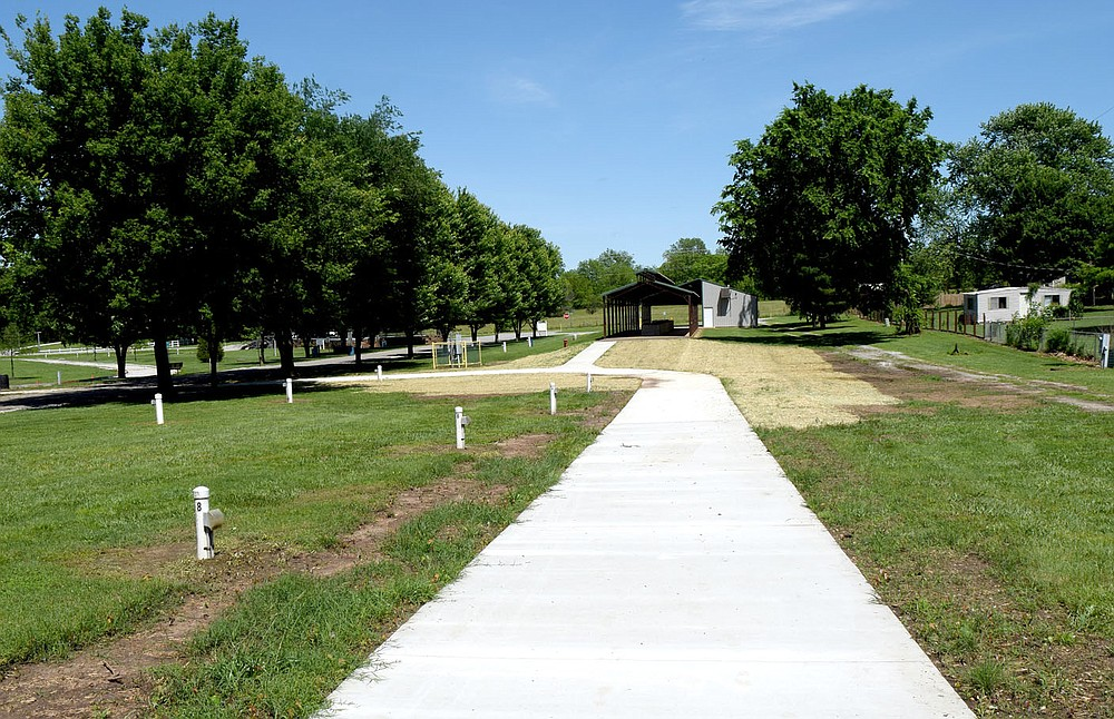 Westside Eagle Observer/MIKE ECKELS Part of the new Veterans Park Walking Trail is ready for use May 28. This section of trail ties the western part of the loop to the quarter mile track near the Veterans Memorial.