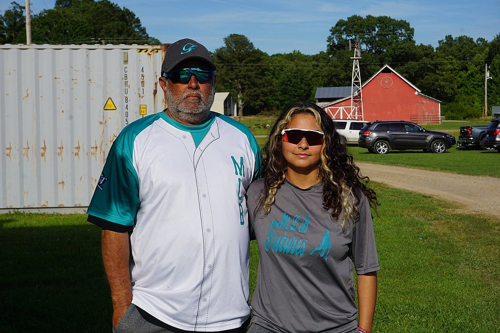 Orlando Mendez stands with his daughter Violet Mendez just outside a baseball field in Lonsdale. Violet Mendez plays baseball for Jessieville High School. - Photo by Krishnan Collins of The Sentinel-Record