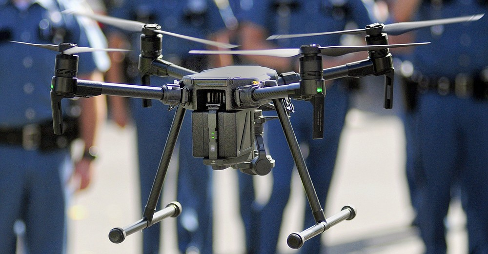 In a Thursday Sept. 28, 2017 file photo, a Maine State Police unmanned aerial vehicle hovers outside Maine State Police headquarters at the Central Maine Commerce Center in Augusta, Me.  More than a year after the U.S. Interior Department grounded hundreds of Chinese-made drones it was using to track wildfires and monitor dams and wildlife, the future of drone use by the federal government remains unmapped. The latest complication: Legislation moving through Congress that would block the U.S. government from using drones made in China. (Joe Phelan/The Kennebec Journal via AP)