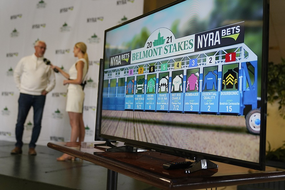 The results of the post-position draw for the 153rd running of the Belmont Stakes horse race are displayed on a screen at Belmont Park in Elmont, N.Y., Tuesday, June 1, 2021.  (AP Photo/Seth Wenig)