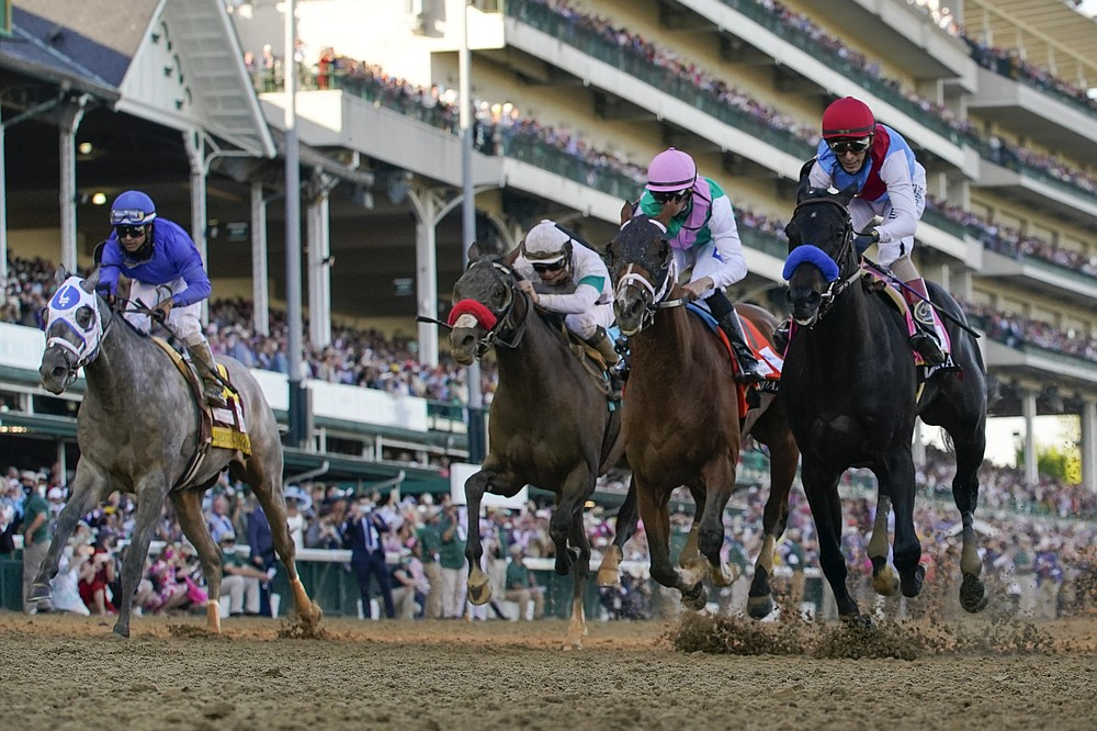 FILE - John Velazquez riding Medina Spirit, right, leads Florent Geroux on Mandaloun, Flavien Prat riding Hot Rod Charlie and Luis Saez on Essential Quality to win the 147th running of the Kentucky Derby at Churchill Downs  in Louisville, Ky., in this Saturday, May 1, 2021, file photo. Essential Quality was set as a 2-1 favorite for the Belmont Stakes. Essential Quality went off as the Derby favorite and finished fourth. (AP Photo/Jeff Roberson, File)