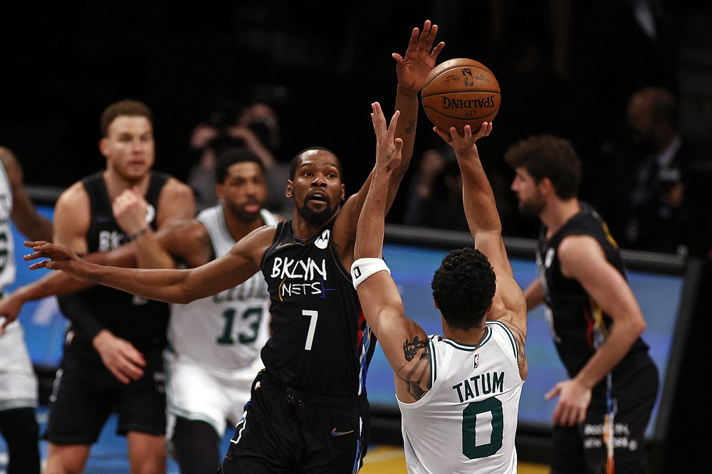 Brooklyn Nets forward Kevin Durant (7) defends a shot by Boston Celtics forward Jayson Tatum (0) in the second half of Game 5 during an NBA basketball first-round playoff series, Tuesday, June 1, 2021, in New York. (AP Photo/Adam Hunger)