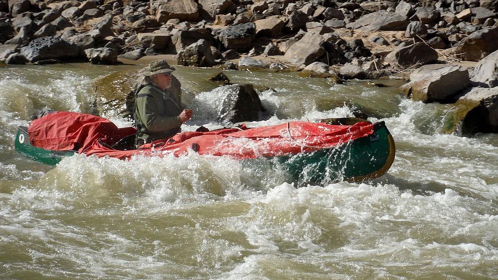 Bob Kramer paddles through a rapid in April 2021 on the San Juan River in southeast Utah. Sixteen people, including 12 canoes and a raft carrying four, paddled 83.5 miles of the San Juan River from the Sand Island Boat Ramp near Bluff, Utah to Clay Hills Crossing Utah. (NWA Democrat-Gazette/David Gottschalk)
