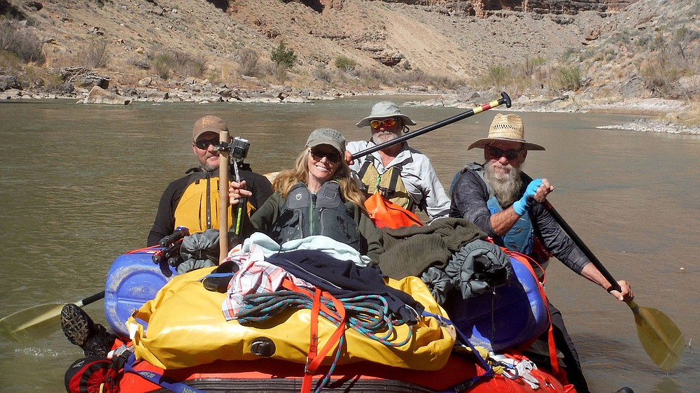 Chris Patrick (from left), Debbie Stillwell, Mark Weathers and Danny Stillwell paddle the raft on the San Juan River in southeast Utah. Sixteen people, including 12 canoes and a raft carrying four, paddled 83.5 miles of the San Juan River from the Sand Island Boat Ramp near Bluff, Ut., to Clay Hills Crossing UT.. Check out nwaonline.com/21____Daily/ and nwadg.com/photos for a photo gallery. (NWA Democrat-Gazette/David Gottschalk)