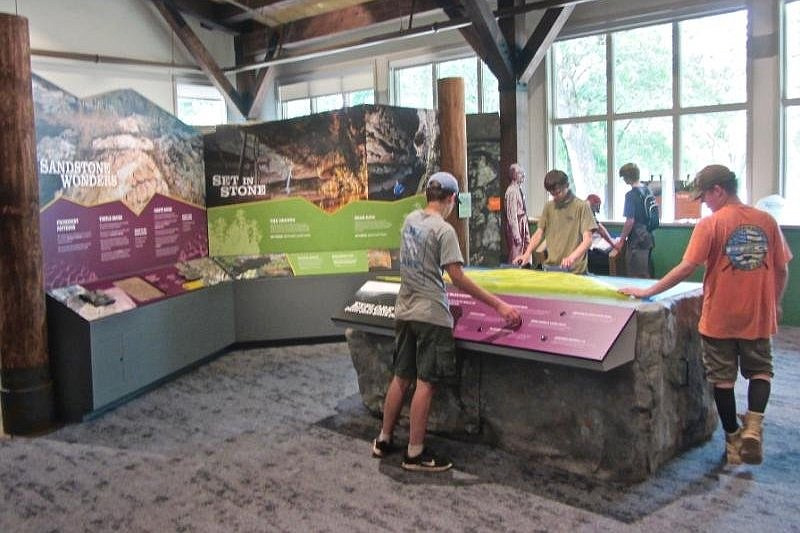 Teenagers study a topographic model of the Petit Jean State Park area. (Special to the Democrat-Gazette/Marcia Schnedler)
