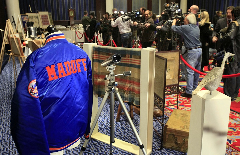 FILE - A New York Mets baseball jacket, personalized for Bernard Madoff, is displayed during an auction preview of his seized items, in New York, Friday, Nov. 13, 2009. Epic Ponzi scheme mastermind Bernard Madoff is dead. But the effort to untangle his web of deceit lives on. More than 12 years after Madoff confessed to running the biggest financial fraud in Wall Street history, a team of lawyers is still at work on a sprawling effort to recover money for the thousands of victims of his scam.(AP Photo/Richard Drew, File)