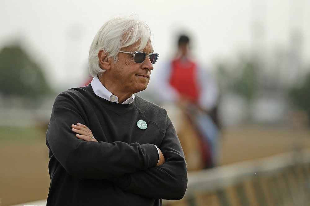 FILE - In this May 1, 2019, file photo, trainer Bob Baffert watches his Kentucky Derby entrant Game Winner during a workout at Churchill Downs in Louisville, Ky. Baffert's lawyer said Wednesday, June 2, 2021, that a split-sample test of Kentucky Derby winner Medina Spirit came back positive for the presence of the steroid betamethasone, which could lead to the horse's disqualification and discipline for the Hall of Fame trainer.  (AP Photo/Charlie Riedel, File)