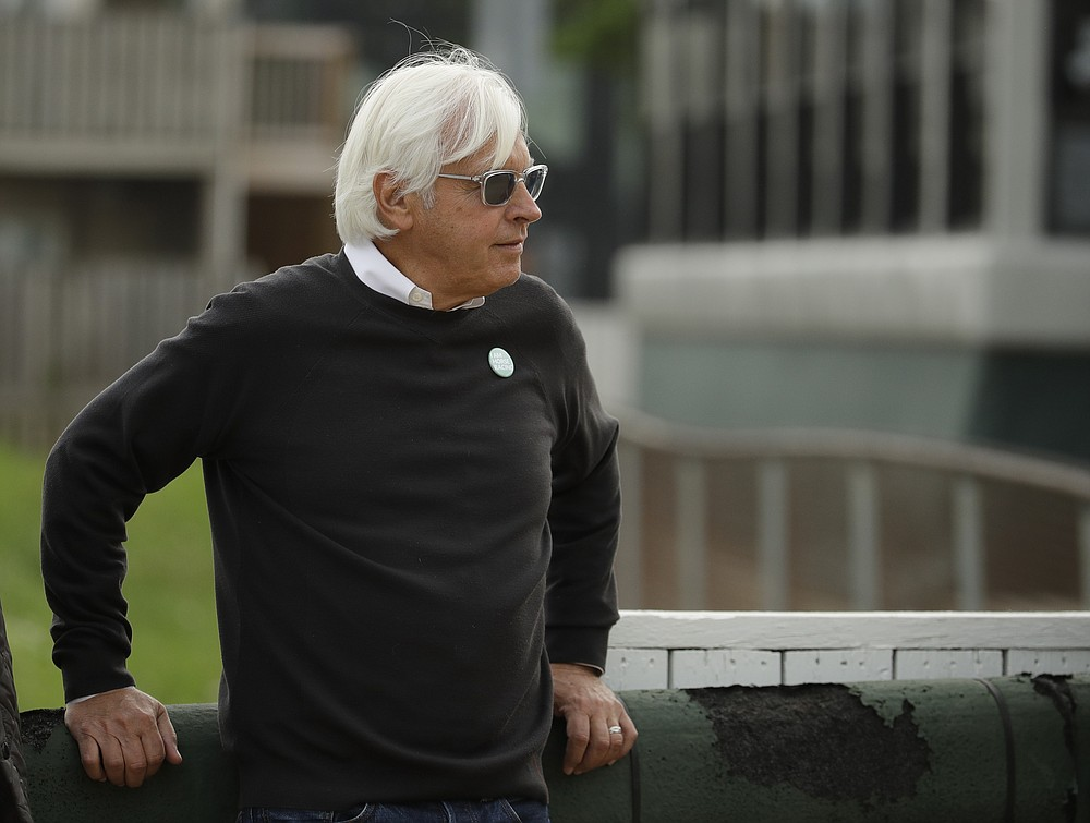 FILE - In this May 1, 2019, file photo, Trainer Bob Baffert watches his Kentucky Derby entrant Game Winner during a workout at Churchill Downs in Louisville, Ky. Baffert was suspended for two years by Churchill Downs on Wednesday, Mune 2, 2021, after an additional drug test of Medina Spirit confirmed the presence of the steroid betamethasone in the Kentucky Derby winner's system. (AP Photo/Charlie Riedel, File)