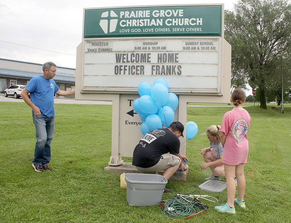 LYNN KUTTER ENTERPRISE-LEADER Prairie Grove Christian Church was one of many businesses and organizations that used their signs to greet Officer Tyler Franks on his way home into town.
