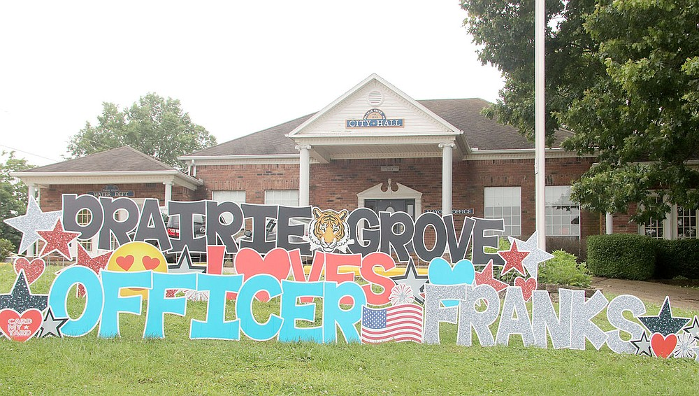 """LYNN KUTTER ENTERPRISE-LEADER This life-size sign was placed in front of Prairie Grove City Hall for the """"Welcome Home"""" parade for Officer Tyler Franks. He was released from a rehabilitation center on June 2 and returned home to continue his recovery."""