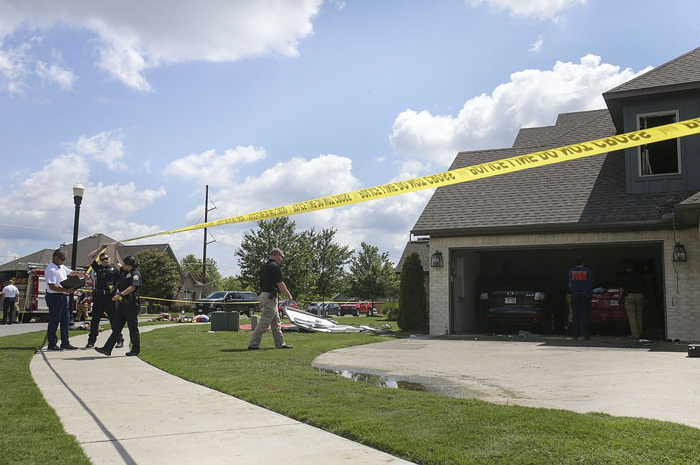 The site of a fatal house fire is shown, Thursday, June 3, 2021 at 3211 SW Riverstone Ave. in Bentonville.  Check out nwaonline.com/210604Daily/ for today's photo gallery.  (NWA Democrat-Gazette/Charlie Kaijo)
