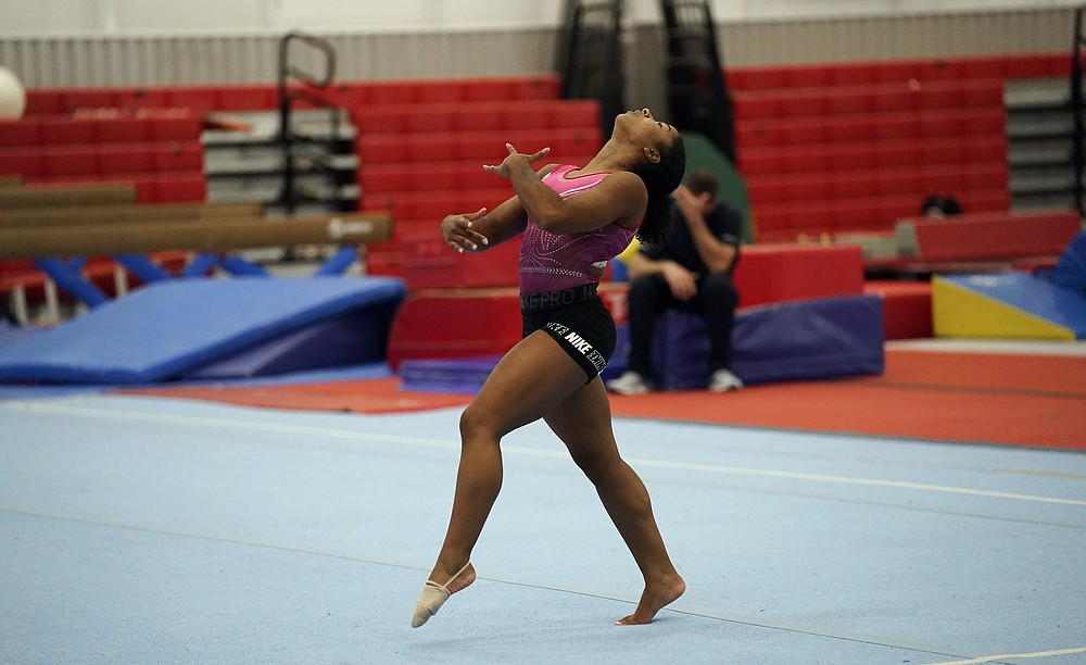FILE - In this May 11, 2021, file photo, gymnast Jordan Chiles practices her floor routine in Spring, Texas. The 20-year-old Chiles will compete at the U.S. Championships this weekend hoping to build off a strong performance at the U.S. Classic, where she finished second to Olympic and world champion Simone Biles. (AP Photo/David J. Phillip, File)