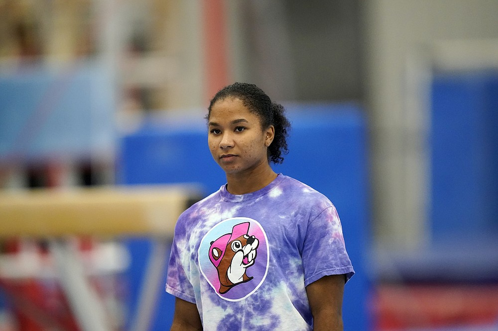 FILE - In this May 11, 2021, file photo, gymnast Jordan Chiles trains in Spring, Texas. Three years ago, Jordan Chiles wasn't sure she wanted to be a gymnast anymore. A move to Texas, a dash of maturity and a renewed confidence in herself have the 20-year-old on the cusp of earning a spot on the U.S. Olympic team. (AP Photo/David J. Phillip, File)