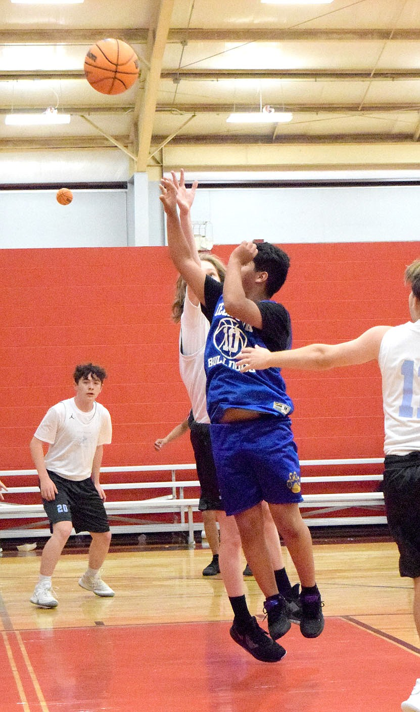 Westside Eagle Observer/MIKE ECKELS Brandon Cruz launches a jumper from inside the lane during the June 8 Decatur-Fort Smith Southside junior high basketball contest at the Arkansas Athletics Outreach gym in Fayetteville. The Mavericks took the team camp contest 26-4 over the Bulldogs.