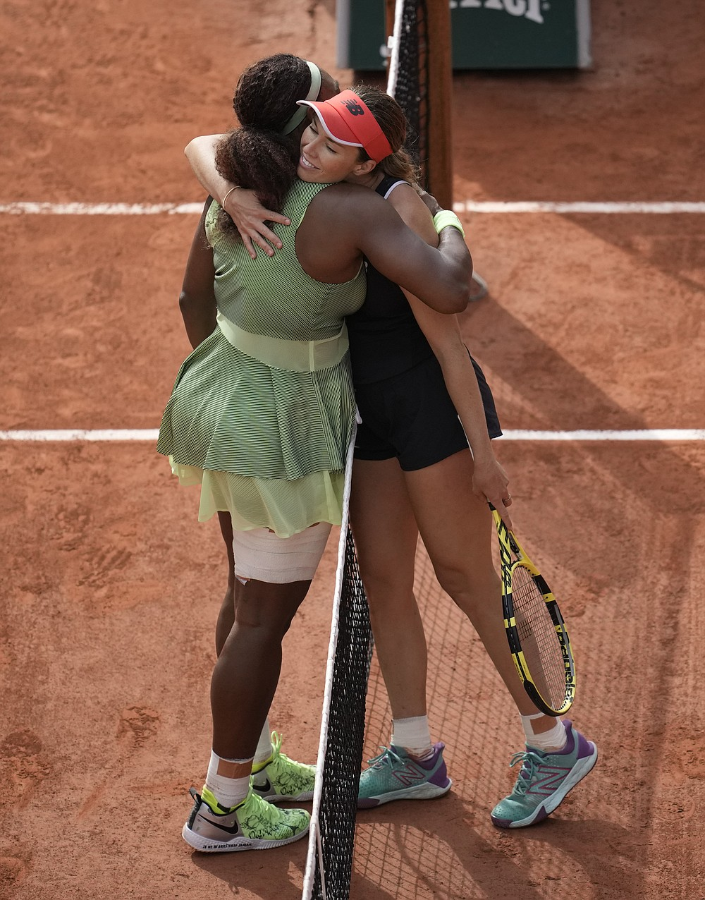 United States Serena Williams, left hugs United States's Danielle Collins after she defeated her in their third round match on day 6, of the French Open tennis tournament at Roland Garros in Paris, France, Friday, June 4, 2021. (AP Photo/Christophe Ena)
