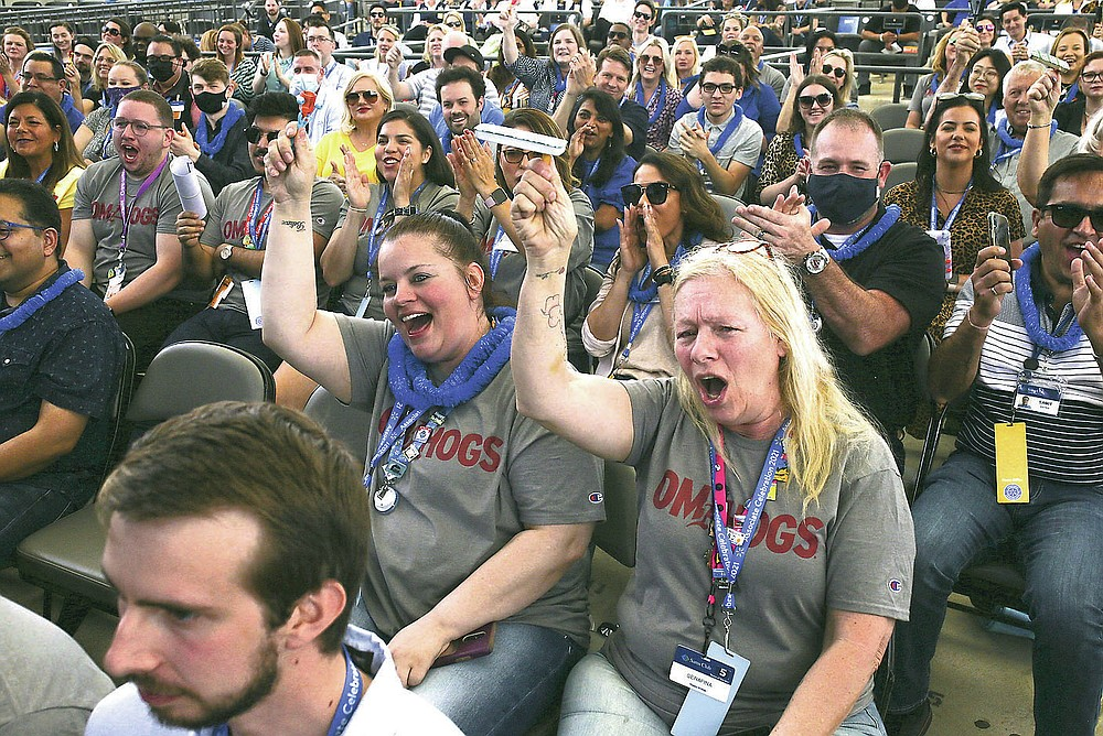 Attendees cheer Friday during the Walmart employee celebration at the Walmart Arkansas Music Pavilion in Rogers. Walmart held its associates meeting mostly online with a small celebration in person. More photos at nwaonline.com/65walmart/. (NWA Democrat-Gazette/Charlie Kaijo)
