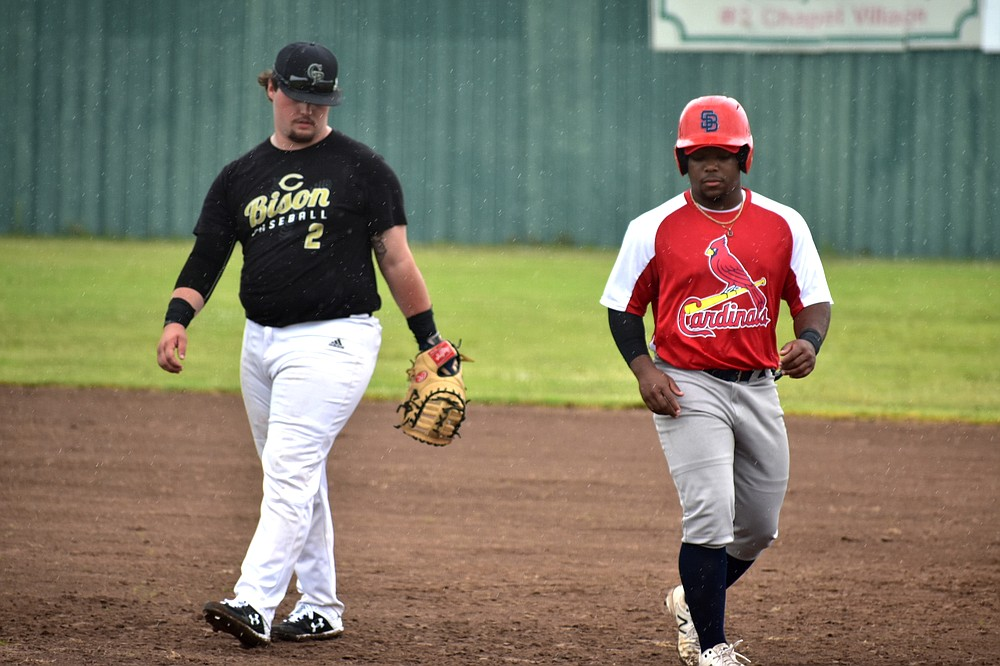 Recent Pine Bluff High School graduate David Carroll, right, playing for the Cardinals, tags up at first base as C-Town first baseman Ian Seidenschwarz looks on Saturday, June 5, 2021, at Taylor Field. (Pine Bluff Commercial/I.C. Murrell)