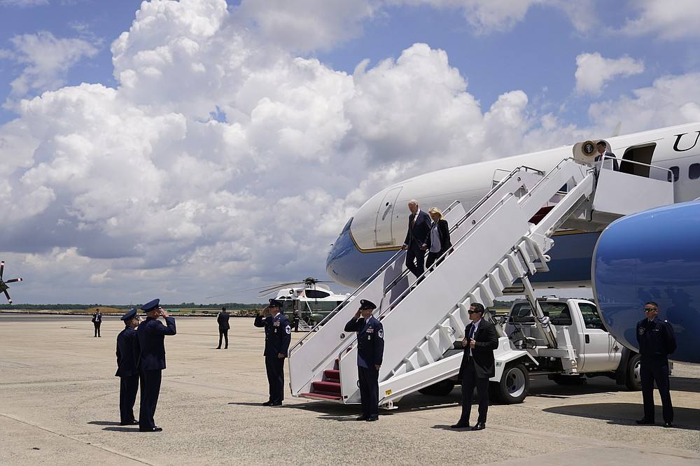 President Joe Biden and first lady Jill Biden walk off Air Force One at Andrews Air Force Base, Md., Friday, June 4, 2021. Biden returns to the White House after spending a few days in Rehoboth Beach to celebrate first lady Jill Biden's 70th birthday. (AP Photo/Andrew Harnik)
