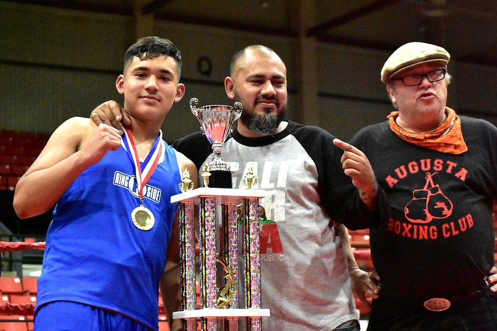 Eddie Montes of Springdale, left, poses with father and trainer Poncho Montes and Arkansas USA Boxing local commission President Bryon Hurford after winning the Ray Rogers Award at the Arkansas State Silver Gloves on Saturday, June 5, 2021, at the Pine Bluff Convention Center. (Pine Bluff Commercial/I.C. Murrell)