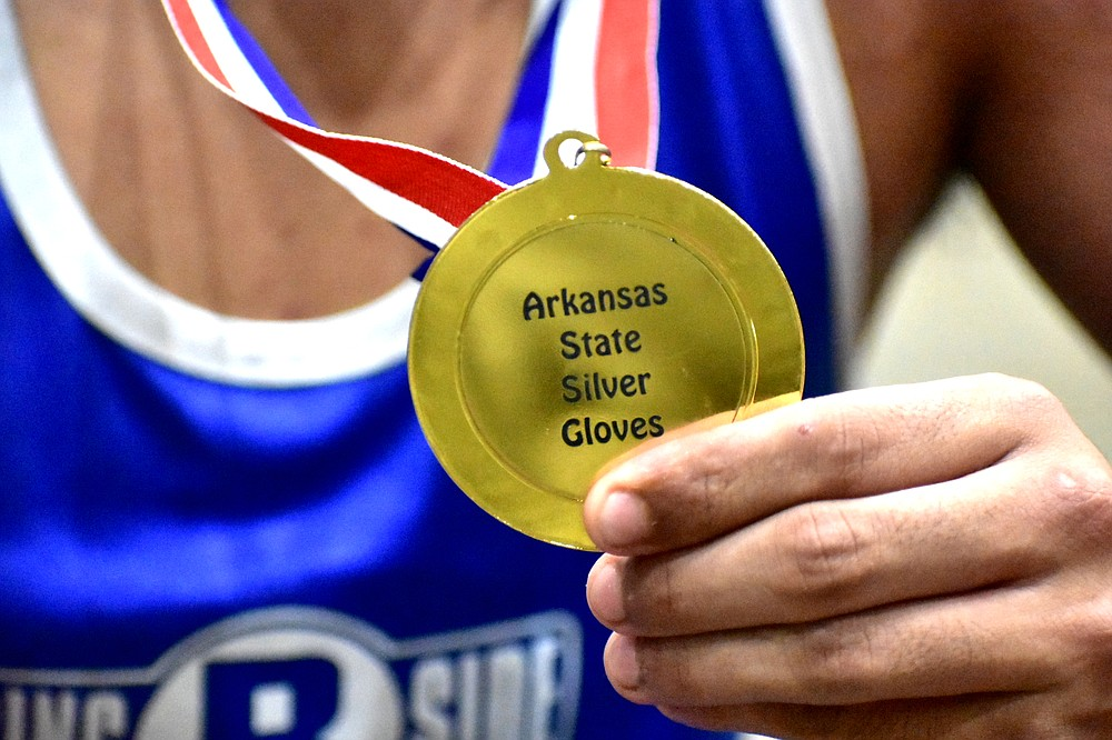 Eddie Montes of Springdale displays his Arkansas State Silver Gloves championship medal on Saturday, June 5, 2021, at the Pine Bluff Convention Center. (Pine Bluff Commercial/I.C. Murrell)