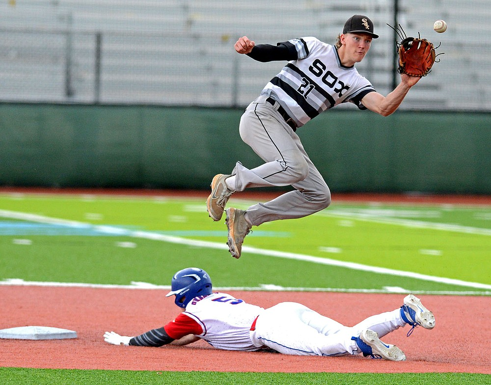 Creighton Prep's Jack Stessman steals second as he slides in under Bryant's JT Parker on Sunday, June 6, 2021 at Hunts Park in Fort Smith during the championship game in the Katzer tournament. (Special to NWA Democrat Gazette/Brian Sanderford)