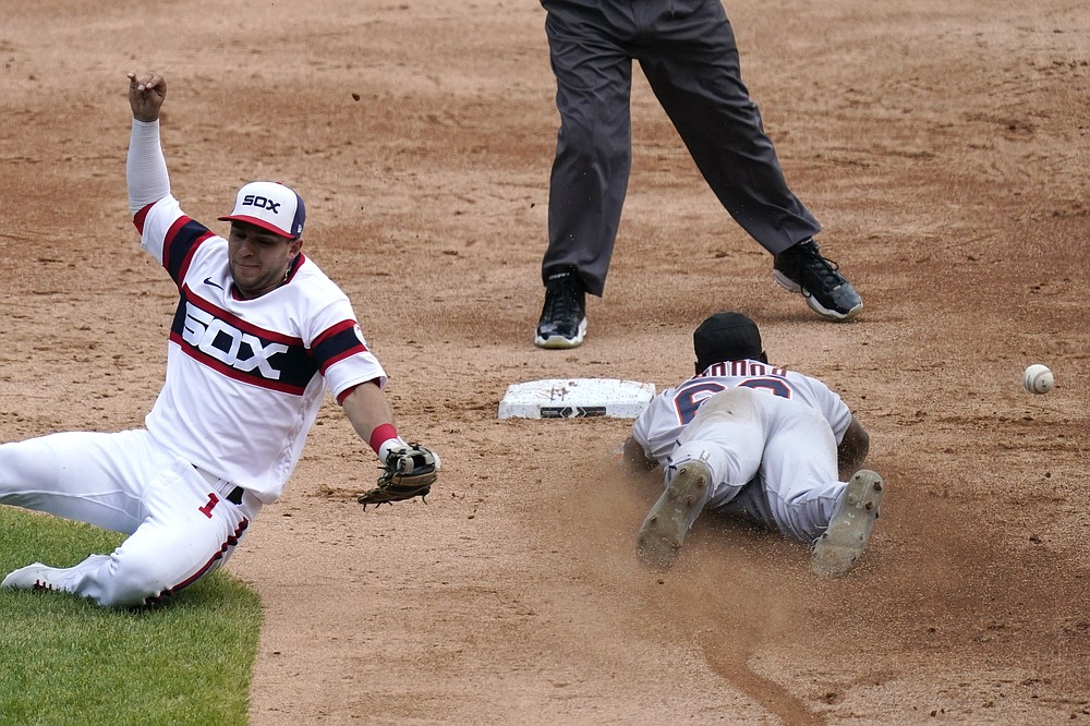 Detroit Tigers' Akil Baddoo, right, steals second as Chicago White Sox second baseman Nick Madrigal, left, cannot make the play on a throwing error by catcher Yasmani Grandal during the third inning of a baseball game in Chicago, Sunday, June 6, 2021. (AP Photo/Nam Y. Huh)