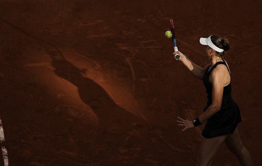 Kazakhstan's Elena Rybakina plays a return to United States Serena Williams during their fourth round match on day 8, of the French Open tennis tournament at Roland Garros in Paris, France, Sunday, June 6, 2021. (AP Photo/Thibault Camus)