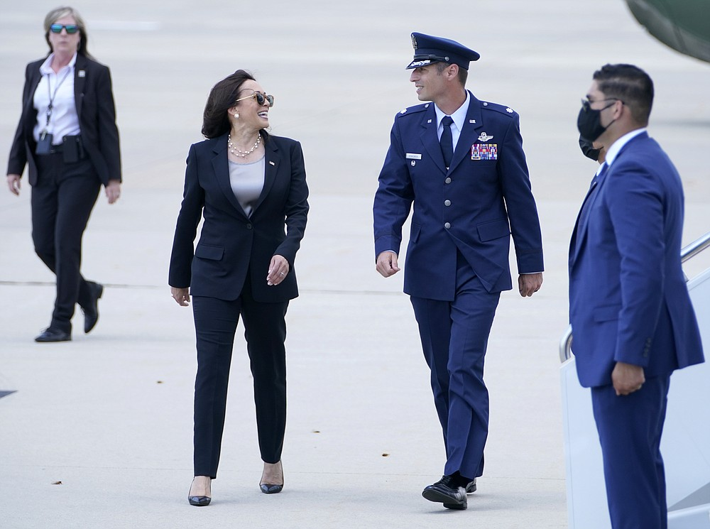 Vice President Kamala Harris speaks with United States Air Force Lt. Col. Neil Senkowski before boarding Air Force Two as she leaves Andrews Air Force Base, Md., Sunday, June 6, 2021, en route to Guatemala City. (AP Photo/Jacquelyn Martin)