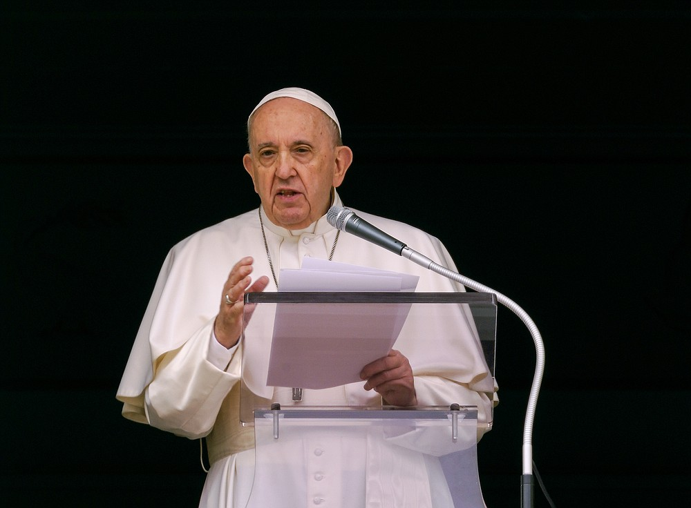 """Pope Francis speaks from the window of his studio overlooking St. Peter's Square at The Vatican to a crowd of faithful and pilgrims gathered for the Sunday Angelus noon prayer, Sunday, June 6, 2021. Pope Francis has expressed sorrow over the discovery in Canada of the remains of 215 boarding school students but didn't offer the apology sought by the Canadian prime minister. Francis in public remarks on Sunday called on political and church authorities to work to shed light """"on this sad affair"""" and to foster healing. (AP Photo/Domenico Stinellis)"""