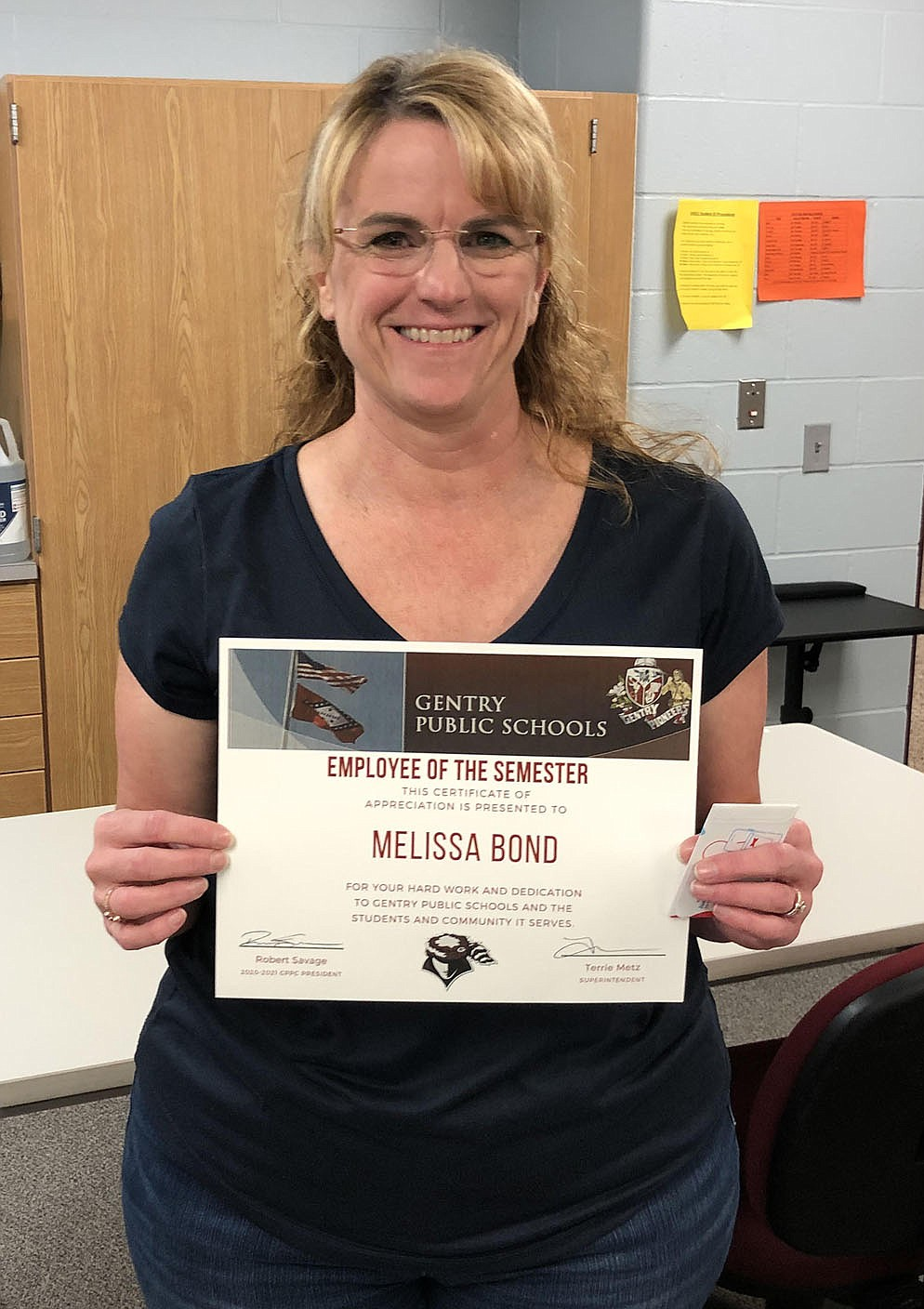 SUBMITTED Melissa Bond received a classified employee of the semester award for her work in the Gentry Public Schools.