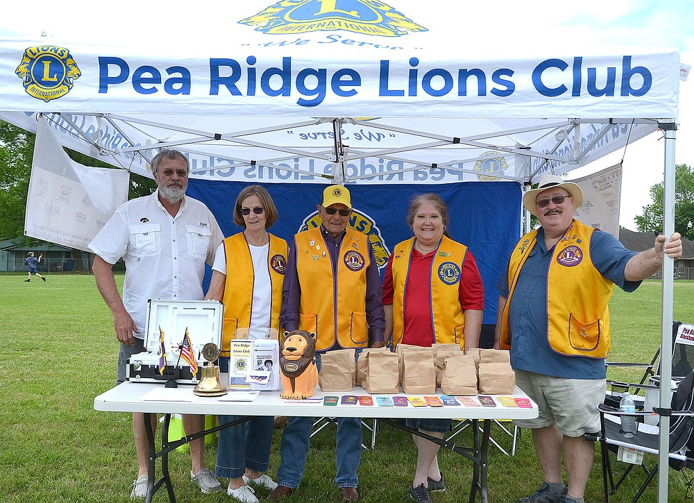 Members of the Pea Ridge Lions Club Steve and Jeanne Hasbrouck, Keith Escue and Renee and Donald Broussard manned a booth at the Saturday event for the Pea Ridge Community Library.