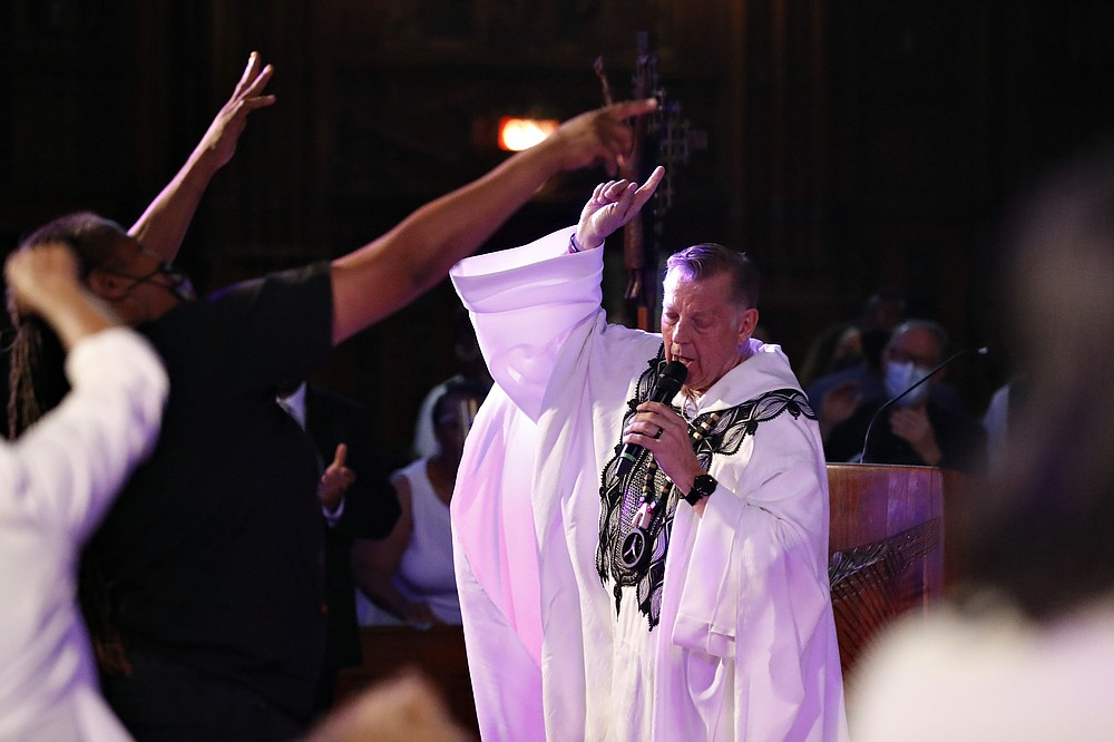 Rev. Michael Pfleger conducts his first Sunday church service as a senior pastor at St. Sabina Catholic Church following his reinstatement by Archdiocese of Chicago after decades-old sexual abuse allegations against minors, Sunday, June 6, 2021, in the Auburn Gresham neighborhood in Chicago. (AP Photo/Shafkat Anowar)