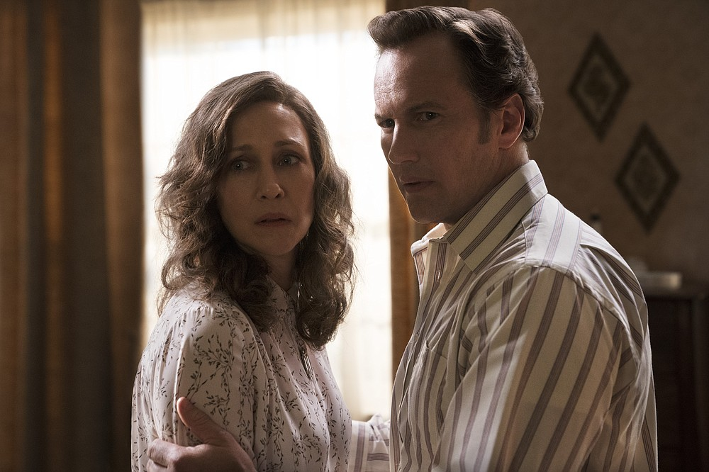 """This image released by Warner Bros. Entertainment shows Vera Farmiga, left, and Patrick Wilson in a scene from """"The Conjuring: The Devil Made Me Do It."""" (Ben Rothstein/Warner Bros. Entertainment via AP)"""