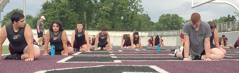 Graham Thomas/Herald-Leader Siloam Springs football players stretch toward the end of Monday's Panther Pride workout at Panther Stadium.