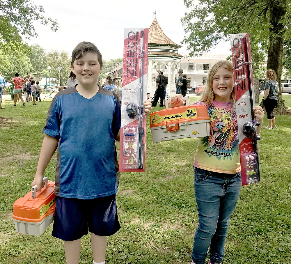 Photo Submitted Pictured are brother and sister Stephen Baker (left), and Esther Baker who each won their age and gender categories for largest fish at the derby. These are some of the prizes they won.