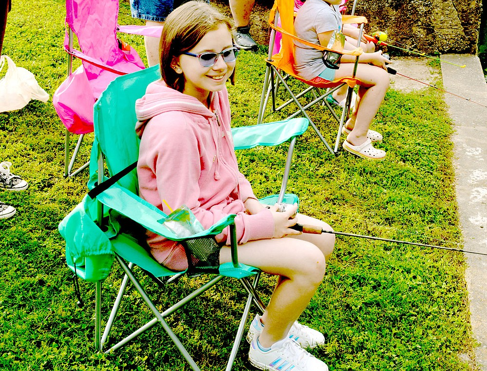Marc Hayot/Herald-Leader Farrah Vaughan, 10, sits back and enjoys the morning as she fishes in the fishing derby held by the Parks and Recreation Department.