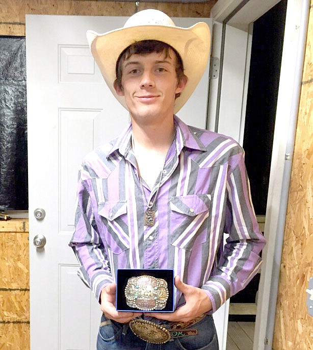 Photo Submitted Colcord native Dason Janes won the bullring event with an overall score of 86 at the Concord Rodeo on Saturday. The buckle that Janes and the participants in other events won were donated by the Cripps family in memory of Greg Cripps.