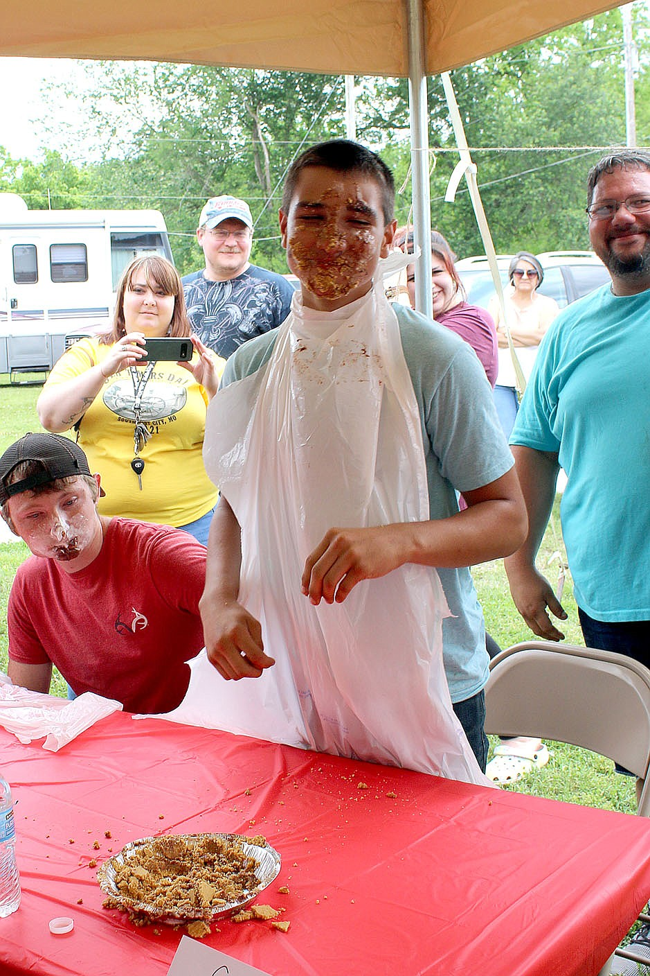 MEGAN DAVIS/MCDONALD COUNTY PRESS Colby Derrick grins with a face full of pride and chocolate pudding after narrowly winning the 2021 Old Timer's Day Pie Eating Contest.