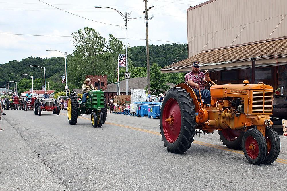 MEGAN DAVIS/MCDONALD COUNTY PRESS A convoy of well-tended farm equipment took over Main Street on Saturday.