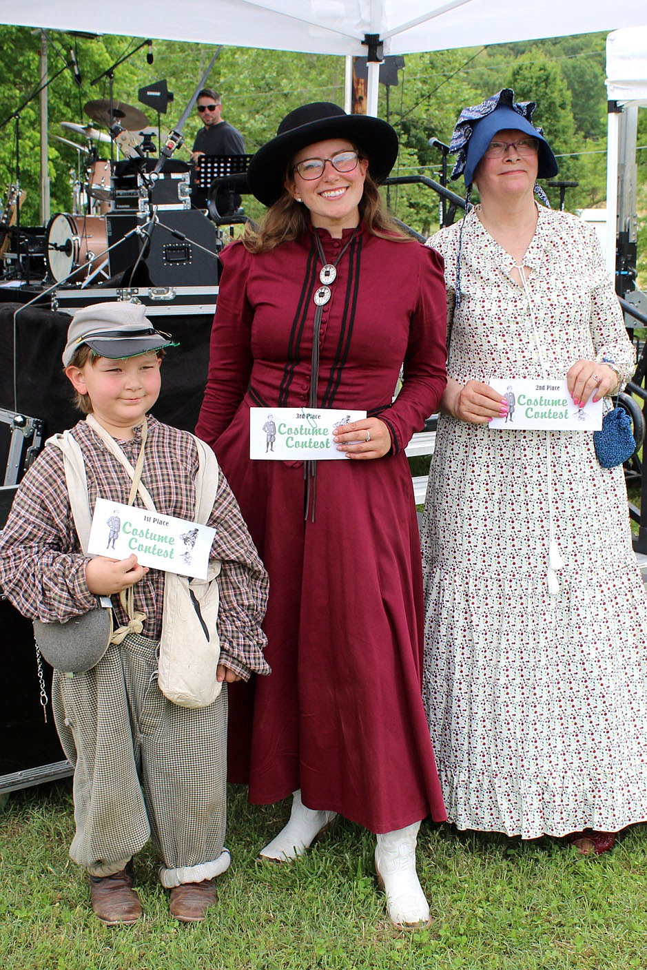 MEGAN DAVIS/MCDONALD COUNTY PRESS (L to R:) Inman Walker, Danni Stewart and Mary Mueller took home award money and bragging rights after winning the Old Timer's Day costume contest.