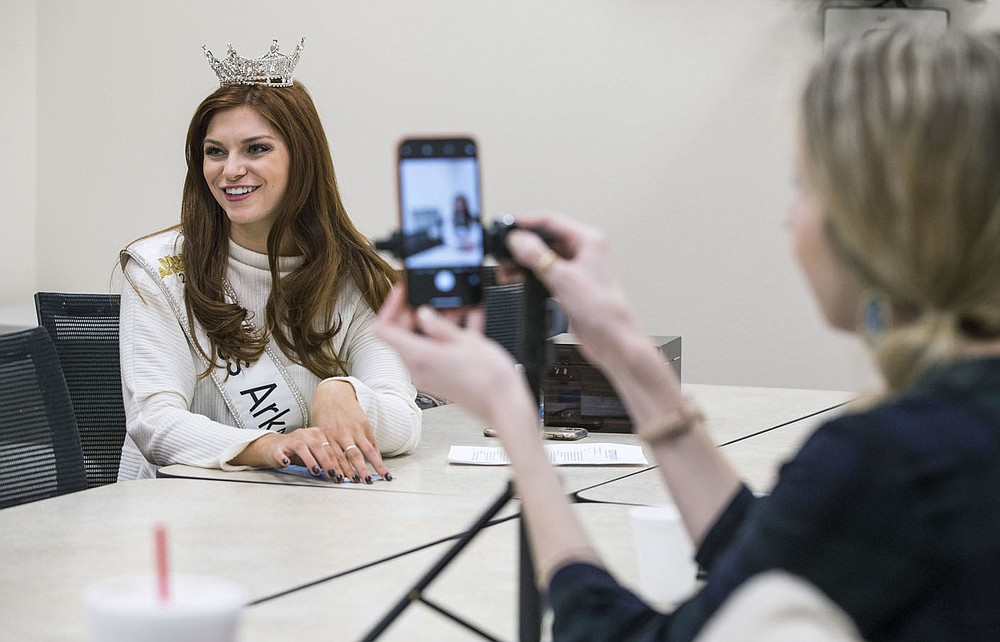 Miss Arkansas Darynne Dahlem records messages Tuesday, Jan. 21, 2020, with Abbie Luzius, community development director with Community Clinic, at the Community Clinic in Fayetteville. The videos will be used on the clinic's social media platforms.   Dahlem, who plans to go to medical school to be a pediatrician, visited the Community Clinic location to learn about the medication assisted treatment program that began in March. Abbie Luzius, community development director with the clinic, said the program employs a wholistic approach to treating opioid addiction beyond just  using medication.    Dahlem described the partnership as a natural fit with her 'Know who you are' platform that fights addiction by encouraging people to resist peer pressure.   Check out nwaonline.com/200122Daily/ for today's photo gallery. (NWA Democrat-Gazette/Ben Goff)