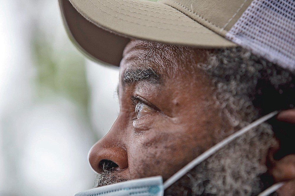 Dozens of Black farmers gather in Byromville, Ga., on Tuesday, May 4, 2021,  to hear U.S. Sen. Rev. Raphael Warnock detail the federal COVID-19 relief coming to them and voice concerns of the history of discrimination against them at the hands of the United States Department of Agriculture. (Riley Bunch/The Daily Times via AP)