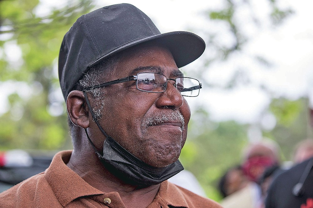 Buena Vista farmer Sylvester Slaughter gets emotional when detailing the discriminatory loan practices of the USDA that hurt Black farmers at a gathering on Tuesday, May 4, 2021, with U.S. Sen. Rev. Raphael Warnock in Byromville, Ga.  (Riley Bunch/The Daily Times via AP)