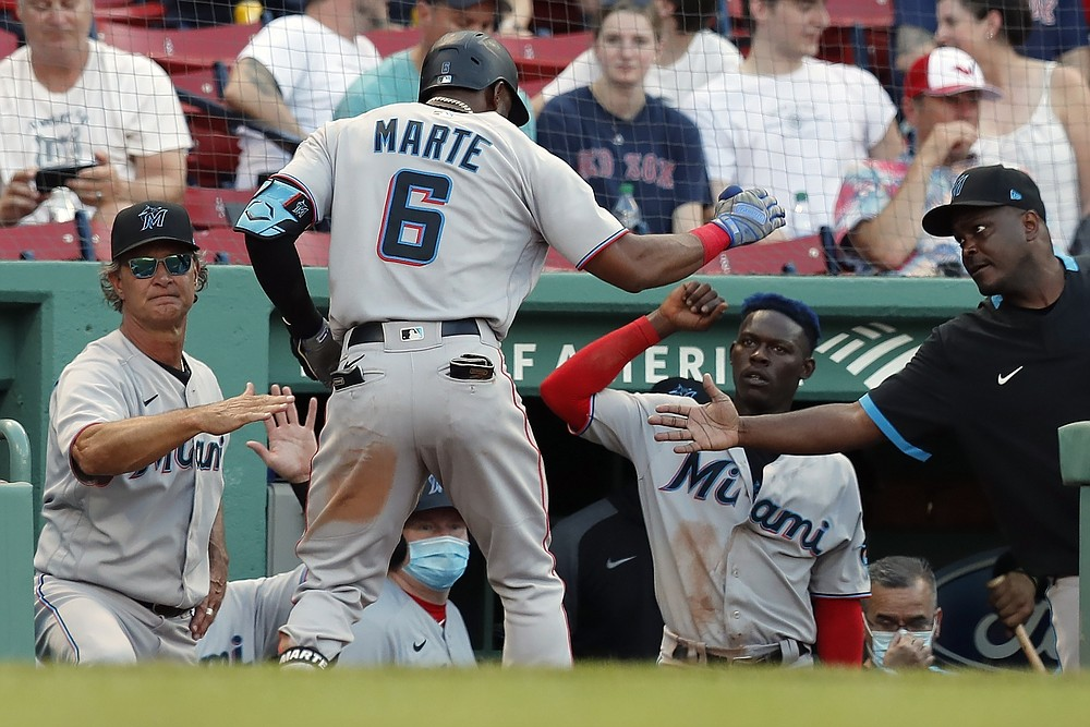 Miami Marlins' Starling Marte (6) celebrates his solo home run during the fifth inning of a baseball game against the Boston Red Sox, Monday, June 7, 2021, in Boston. (AP Photo/Michael Dwyer)