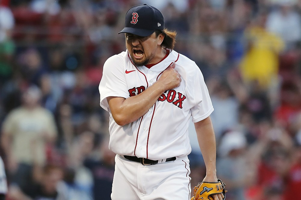 Boston Red Sox's Hirokazu Sawamura reacts after striking out Miami Marlins' Jesus Aguilar with the bases loaded to retire the side during the sixth inning of a baseball game, Monday, June 7, 2021, in Boston. (AP Photo/Michael Dwyer)