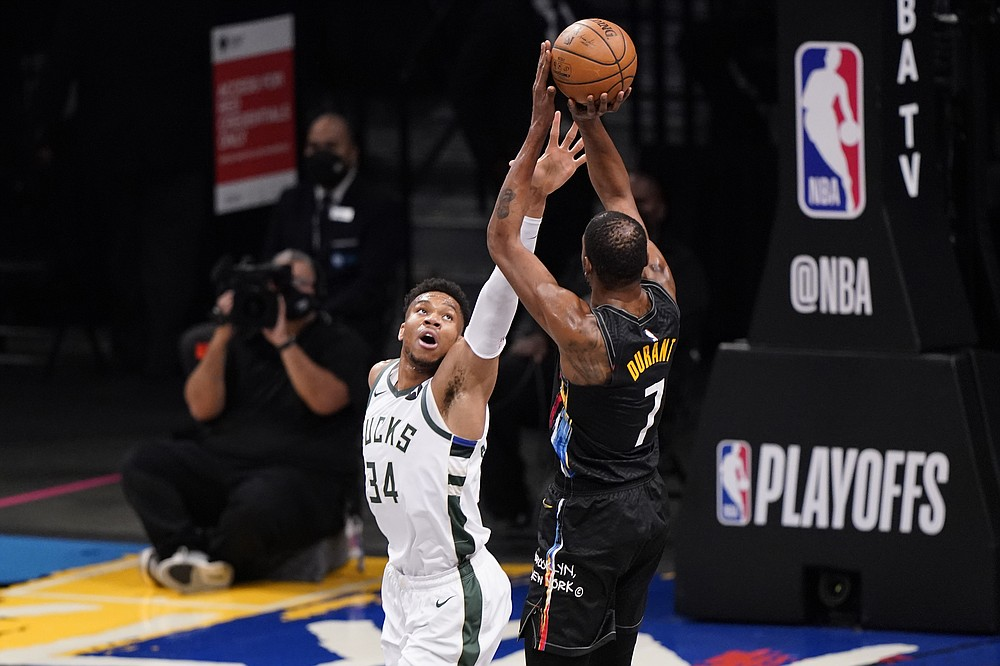 Milwaukee Bucks forward Giannis Antetokounmpo (34) defends against Brooklyn Nets forward Kevin Durant (7) during the first half of Game 2 of an NBA basketball second-round playoff series, Monday, June 7, 2021, in New York. (AP Photo/Kathy Willens)