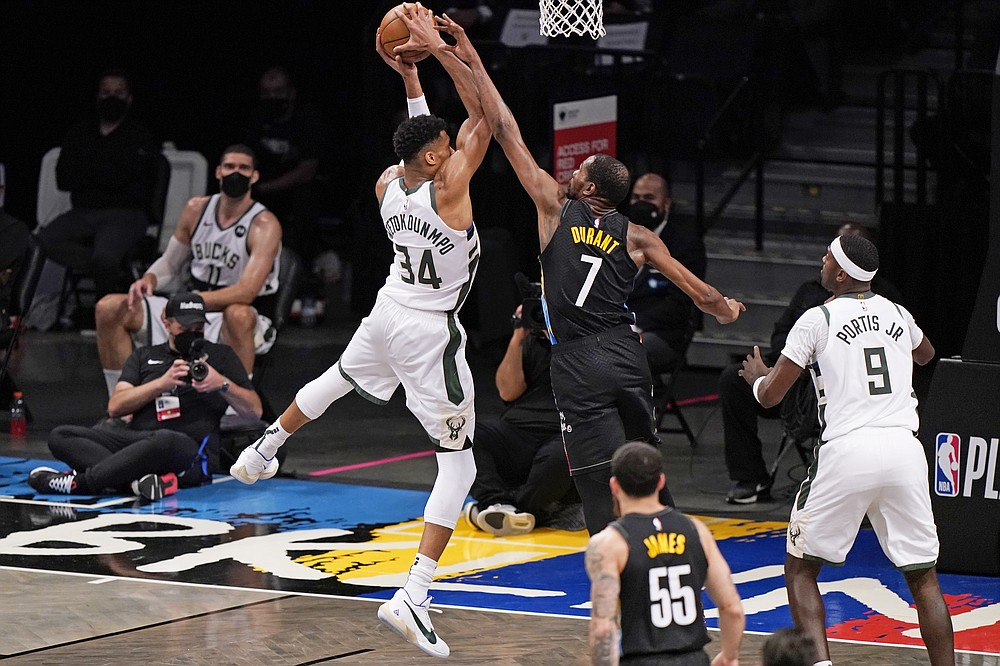 Brooklyn Nets forward Kevin Durant (7) tries to block a shot by Milwaukee Bucks forward Giannis Antetokounmpo (34) as Bucks center Bobby Portis (9) looks on during the third quarter of Game 2 of an NBA basketball second-round playoff series, Monday, June 7, 2021, in New York. (AP Photo/Kathy Willens)
