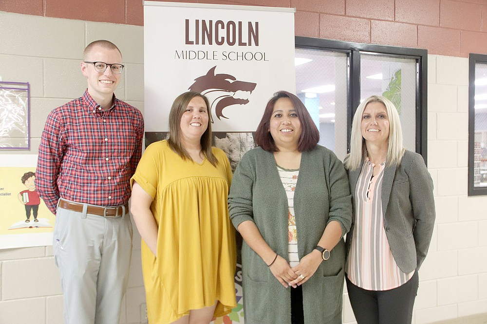 LYNN KUTTER ENTERPRISE-LEADER Michele Price, Lincoln Middle School principal, right, stands with her multi-classroom leaders for the school's Opportunity Culture program: Tyler McBride, left, Lindsay Bounds and Yvette Townsend. LMS has been named an Opportunity Culture Model School.