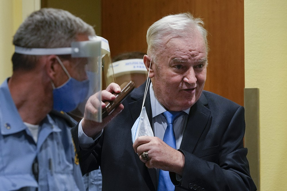 Former Bosnian Serb military chief Ratko Mladic enters the court room in The Hague, Netherlands, Tuesday, June 8, 2021, where the United Nations court delivers its verdict in the appeal of Mladic against his convictions for genocide and other crimes and his life sentence for masterminding atrocities throughout the Bosnian war. (AP Photo/Peter Dejong, Pool)